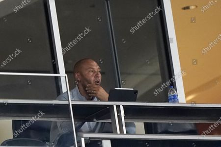 Miami Marlins CEO Derek Jeter watches during the first inning of a baseball game between the Marlins and the Atlanta Braves, in Miami