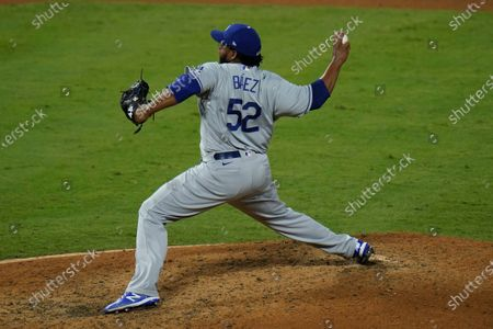 Los Angeles Dodgers relief pitcher Pedro Baez throws against the Los Angeles Angels during the eighth inning of a baseball game, in Anaheim, Calif
