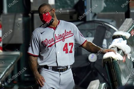 Washington Nationals designated hitter Howie Kendrick wears a face mask to protect against COVID-19 as he reacts to comments in the dugout during the fifth inning of a baseball game against the Baltimore Orioles, in Baltimore