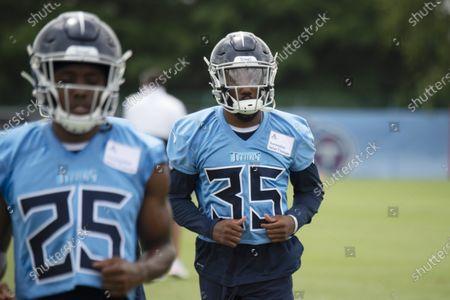 Tennessee Titans cornerback Adoree' Jackson (25) and defensive back Chris Jackson (35) loosen up during NFL football training camp, in Nashville, Tenn