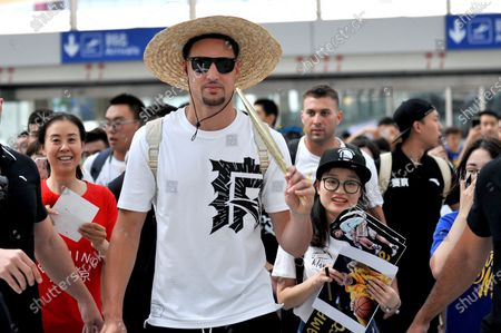 American professional basketball player Klay Thompson shows at the airport in Beijing.
