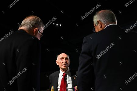 Australian Prime Minister Scott Morrison (R) and Australian Opposition Leader Anthony Albanese (L) speak to Australian War Veteran Les Cook (C) at a service to commemorate the 75th anniversary of the Victory in the Pacific Day at the Australian War Memorial in Canberra, Australia, 15 August 2020.