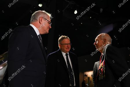 Stock Image of Australian Prime Minister Scott Morrison (L) and Australian Opposition Leader Anthony Albanese (C) speak to Australian War Veteran Les Cook (R) at a service to commemorate the 75th anniversary of the Victory in the Pacific Day at the Australian War Memorial in Canberra, Australia, 15 August 2020.