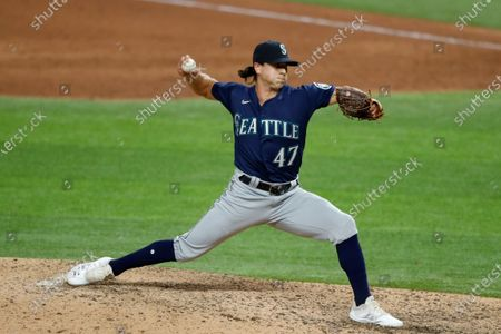Seattle Mariners relief pitcher Taylor Williams works against the Texas Rangers in a baseball game in Arlington, Texas