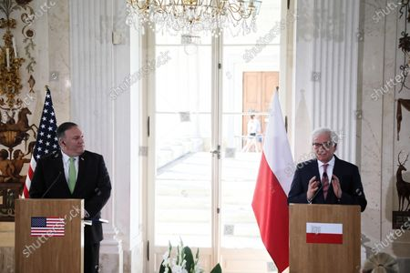 Polish Foreign Minister Jacek Czaputowicz (R) and US Secretary of State Mike Pompeo (L) attend a press conference after their meeting in Warsaw, Poland, 15 August 2020. US Secretary of State Mike Pompeo has come to Warsaw to meet with Poland's top officials, sign a new US-Poland defense deal and attend the commemoration of the centennial of the 1920 Battle of Warsaw, in which Polish forces defeated the Bolsheviks. POLAND OUT