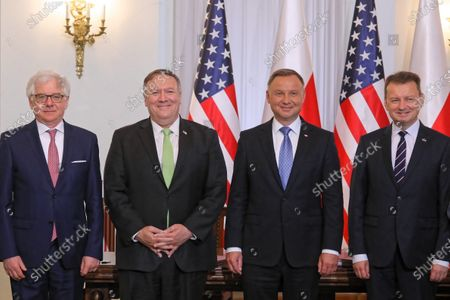 (L-R) Polish Foreign Minister Jacek Czaputowicz, US Secretary of State Mike Pompeo, Polish President Andrzej Duda and Polish Defense Minister Mariusz Blaszczak pose for a group photograph after signing the new US-Poland Enhanced Defense Cooperation Agreement (EDCA) during their meeting at the Presidential Palace in Warsaw, Poland, 15 August 2020.  POLAND OUT
