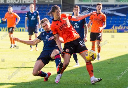 Ross County's Connor Randall (left) tussles with Dundee United's Ian Harkes during the Scottish Premiership match between Ross County & Dundee United at The Global Energy Stadium, Dingwall on 15th August 2020.