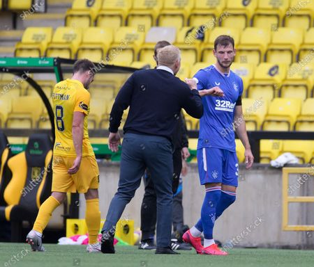 Livingston Manager Gary Holt commiserates Borna Barisic of Rangers after the final whistle of the 0-0 Scottish Premiership match between Livingston & Rangers at the  Alderston Road at Almondvale Stadium, Livingston on 16th August 2020. Livingston goalkeeper Max Stryjek made an amazing save to deny Barisic a goal from a direct free kick late in the game.