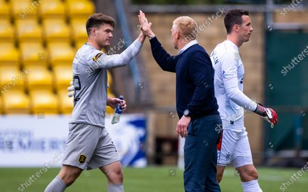 Livingston Manager Gary Holt high fives Livingston goalkeeper Max Stryjek as he walks off the pitch at full-time after a 0-0 Darw in the Scottish Premiership match between Livingston & Rangers at the  Alderston Road at Almondvale Stadium, Livingston on 16th August 2020.