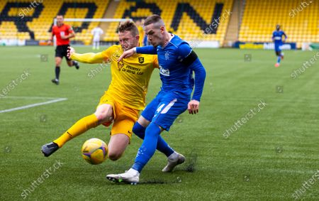 Nicky Devlin of Livingston tries to block a cross from Ryan Kent of Rangers during the Scottish Premiership match between Livingston & Rangers at the  Alderston Road at Almondvale Stadium, Livingston on 16th August 2020.