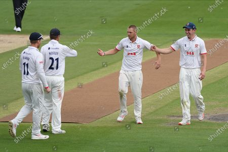 Wicket - Jamie Porter of Essex is congratulated after  Harry Finch was caught by Sir Alistair Cook for 21 during the Bob Willis Trophy match between Sussex County Cricket Club and Essex County Cricket Club at the 1st Central County Ground, Hove