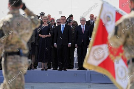 Polish President Andrzej Duda (C) with his wife Agata Konrhauser-Duda (L) and Polish Foreign Minister Jacek Czaputowicz (R) attend the ceremony marking 100th anniversary of the Battle of Warsaw in front of the Tomb of the Unknown Soldier at the Jozef Pilsudski Square in Warsaw, Poland, 15 August 2020. The Battle of Warsaw, also known as the Miracle of the Vistula, was a series of battles that resulted in a decisive Polish victory in 1920 during the Polish-Soviet War.