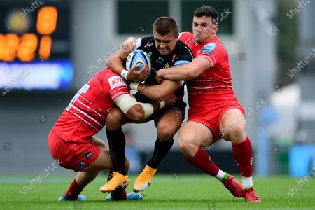 Stock Picture of Henry Slade of Exeter Chiefs is tackled by Dan Cole of Leicester Tigers and Matt Scott of Leicester Tigers