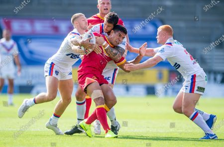 Catalans David Mead is tackled by Wakefield's Jay PItts & Josh Wood.