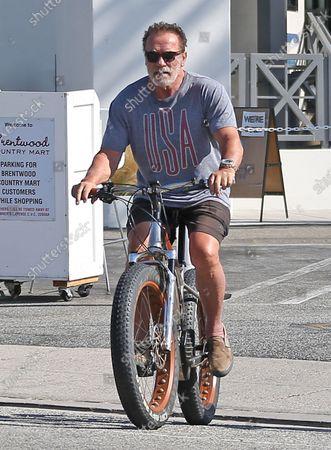 Arnold Schwarzenegger seen riding his bike in Brentwood