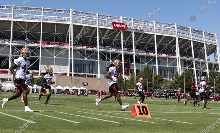 San Francisco 49ers cornerback Richard Sherman (25), center, works out during NFL football training camp practice, at the SAP Performance Facility in Santa Clara, Calif