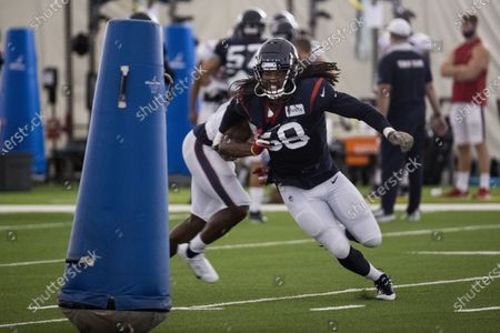 Houston Texans linebacker Peter Kalambayi (58) runs past running back David Johnson on a pass rush drill during NFL football training camp practice in Houston