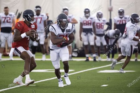 Houston Texans quarterback Deshaun Watson (4) drops back to pass behind running back David Johnson during NFL football training camp practice in Houston
