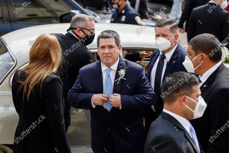 Former Paraguayan President Horacio Cartes arrives for the marriage of his daughter Sol Cartes with businessman Patrick Bendlin, at the Metropolitan Cathedral of Asuncion, Paraguay, 15 August 2020. Former President Horacio Cartes (2013-2018) was rebuked with allegations of corruption by a group of people at the entrance of the Cathedral of Asuncion when he arrived to his daughter Sol Cartes' wedding with the businessman Patrick Bendlin.