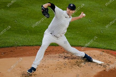 New York Yankees' James Paxton delivers a pitch during the first inning of a baseball game against the Boston Red Sox, in New York