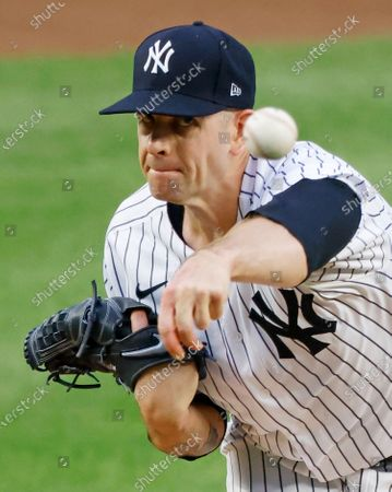 New York Yankees starting pitcher James Paxton releases a pitch to the Boston Red Sox in the first inning during the first inning of a MLB game at Yankee Stadium in the Bronx, New York, USA, 15 August 2020.