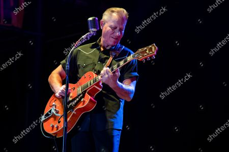 Stock Photo of Jim Heath of The Reverend Horton Heat performs on the Wolfman Jack Stage at Buffalo Chip during the 80th annual Sturgis Motorcycle Rally, in Sturgis, S.D