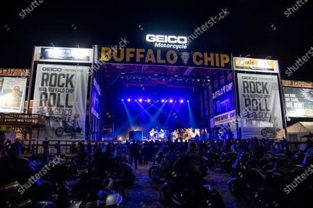 Stock Picture of Motorcycles are parked in the audience during The Reverend Horton Heat's performance on the Wolfman Jack Stage at Buffalo Chip during the 80th annual Sturgis Motorcycle Rally, in Sturgis, S.D
