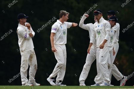 Tom Scriven (second from left) and Hampshire celebrate the wicket of Jamie Smith during the Bob Willis Trophy match between Hampshire County Cricket Club and Surrey County Cricket Club at Arundel Castle, Arundel