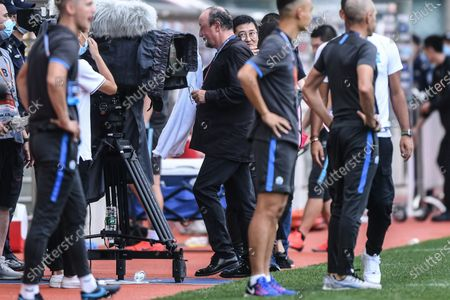 Rafael Benitez (C), head coach of Dalian Yifang, leaves after the fifth round match between Guangzhou R&F and Dalian Yifang at the postponed 2020 season Chinese Football Association Super League (CSL) Dalian Division in Dalian, northeast China's Liaoning Province, Aug. 16, 2020.