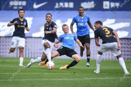 Mousa Dembele (2nd L) of Guangzhou R&F vies with Sam Larsson (C) of Dalian Yifang during the fifth round match between Guangzhou R&F and Dalian Yifang at the postponed 2020 season Chinese Football Association Super League (CSL) Dalian Division in Dalian, northeast China's Liaoning Province, Aug. 16, 2020.