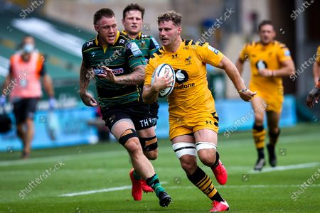Stock Picture of Thomas Young of Wasps goes past Teimana Harrison of Northampton Saints