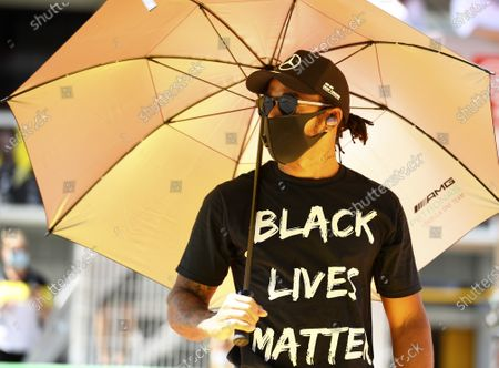 Mercedes driver Lewis Hamilton of Britain wearing a Black Lives Matter shirt walks in the pit lane prior the Formula One Grand Prix at the Barcelona Catalunya racetrack in Montmelo, Spain