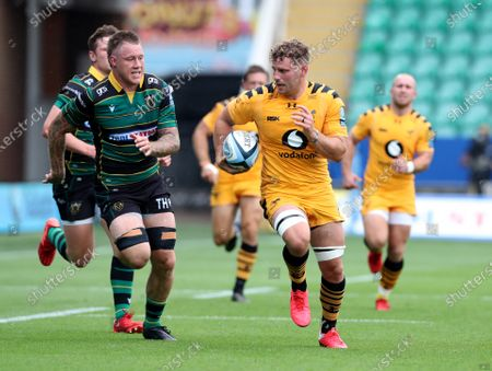 Thomas Young of Wasps gets away from Teimana Harrison of Northampton