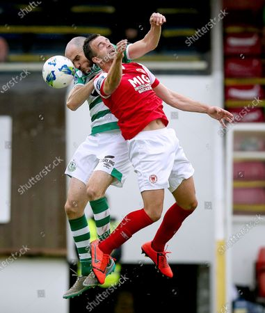 St. Patrick's Athletic vs Shamrock Rovers. St. Patrick's Athletic's Robbie Benson with Joey O'Brien of Shamrock Rovers