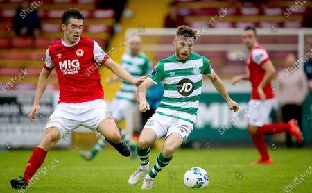St. Patrick's Athletic vs Shamrock Rovers. St. Patrick's Athletic's Lee Desmond with Jack Byrne of Shamrock Rovers