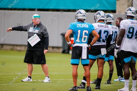 Carolina Panthers special teams assistant coach Ed Foley, left, directs players during NFL football training camp practice in Charlotte, N.C