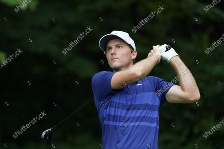 Russell Henley watches his shot on the second tee during the final round of the Wyndham Championship golf tournament at Sedgefield Country Club, in Greensboro, N.C