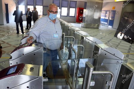 A passenger passes through a gate ticket machine, in Adly Mansour metro station in Cairo, Egypt, 16 August 2020. 6 new stations opened on 16 August 2020 as part of the fourth phase of the third line in Cairo's metro.