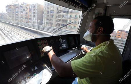 A train driver in Adly Mansour metro station in Cairo, Egypt, 16 August 2020. 6 new stations opened on 16 August 2020 as part of the fourth phase of the third line in Cairo's metro.
