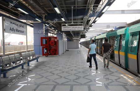 Passengers boarding a train in the newly opened Adly Mansour metro station in Cairo, Egypt, 16 August 2020. 6 new stations opened on 16 August 2020 as part of the fourth phase of the third line in Cairo's metro.