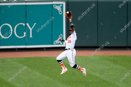 Baltimore Orioles left fielder Dwight Smith Jr. (35) jumps up to catch a ball hit by Washington Nationals' Carter Kieboom for an out during the first inning of a baseball game, in Baltimore