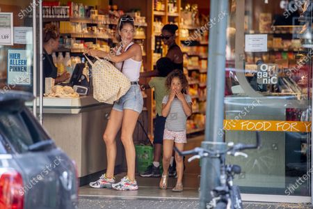 Doutzen Kroes shops and rides bikes with her chidren, Myllena Gorre and Phyllon Gorre