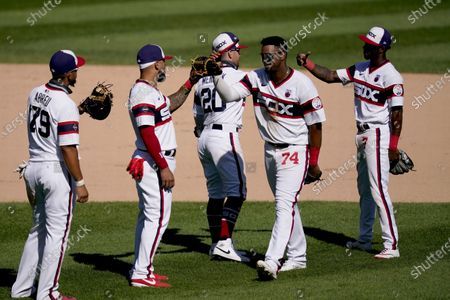 The Chicago White Sox from left, Jose Abreu (79), Yoan Moncada, Danny Mendick (20) Eloy Jimenez (74) and Tim Anderson, celebrate the team's 7-2 win over the St. Louis Cardinals after a baseball game, in Chicago