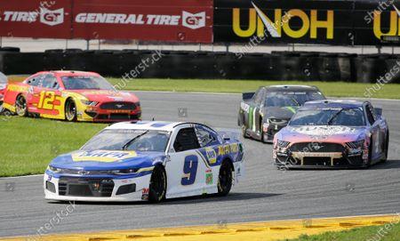 Chase Elliott (9) leads Kevin Harvick (4), Kurt Busch (1) and Ryan Blaney through Turn 3 during a NASCAR Cup Series auto race at Daytona International Speedway, in Daytona Beach, Fla