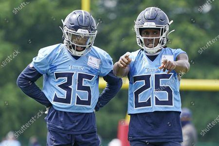 Tennessee Titans cornerback Adoree' Jackson (25) talks with defensive back Chris Jackson (35) during NFL football training camp, in Nashville, Tenn