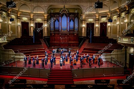 Stock Image of Princess Beatrix (C) stands on the stage in the Concertgebouw after a concert by the European Union Youth Orchestra in Amsterdam, the Netherlands, 16 August 2020.