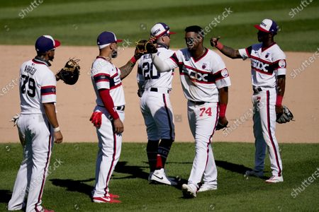Stock Image of The Chicago White Sox from left, Jose Abreu (79), Yoan Moncada, Danny Mendick (20) Eloy Jimenez (74) and Tim Anderson, celebrate the team's 7-2 win over the St. Louis Cardinals after a baseball game, in Chicago