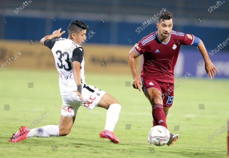 Pyramids FC player Abdallah El Said (R) in action against Tala'ea El Gaish SC playerAmar Hamdy  (L) during the Egyptian league soccer match between Pyramids FC and Tala'ea El Gaish SC  at 30 June Stadium in Cairo, Egypt, 16 August 2020.
