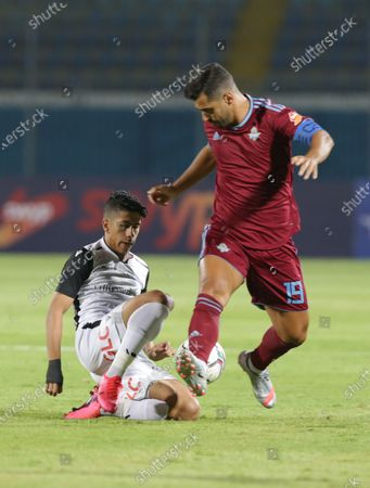 Pyramids FC  player Abdallah El Said (R) in action against Tala'ea El Gaish SC player Amaar Hamdy (L) during the Egyptian league soccer match between Pyramids FC and Tala'ea El Gaish SC  at 30 June Stadium in Cairo, Egypt, 16 August 2020.
