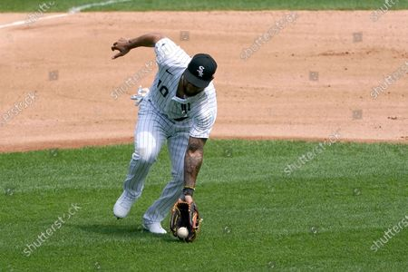 Stock Picture of Chicago White Sox third baseman Yoan Moncada fields a ground ball during a baseball game against the St. Louis Cardinals, in Chicago